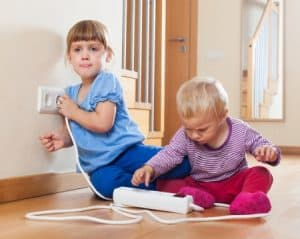 24830917 Children Playing With Electrical Extension And Outlet At Home
