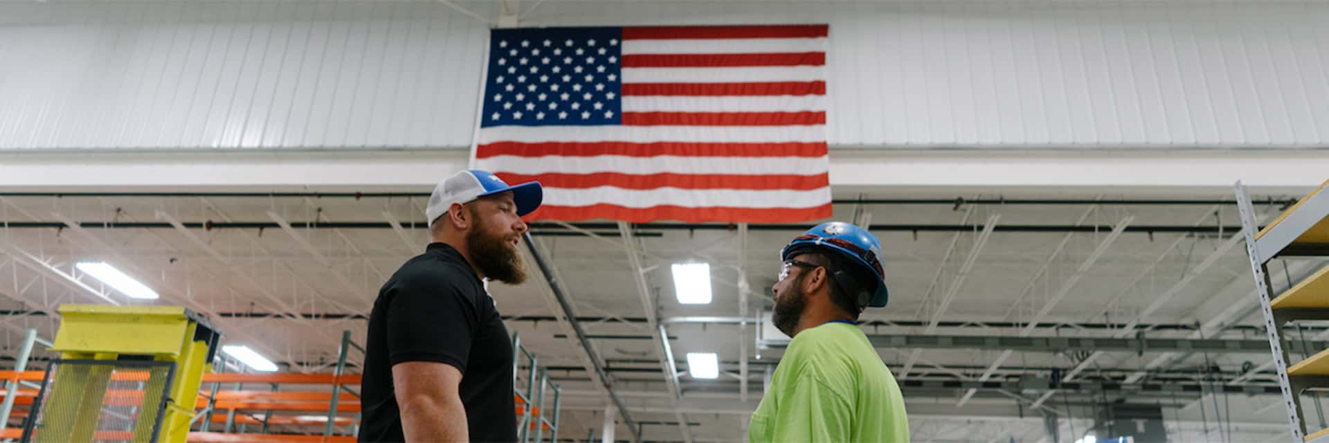 electricians talking under American flag